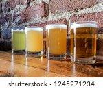 craft beer flight of four ipa's ...   Shutterstock . vector #1245271234