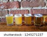 craft beer flight of four ipa's ...   Shutterstock . vector #1245271237