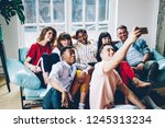 positive multicultural young... | Shutterstock . vector #1245313234