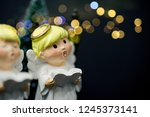 christmas caroling or carolers... | Shutterstock . vector #1245373141