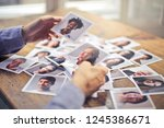 hands selecting photos of... | Shutterstock . vector #1245386671