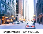 blurred busy street alley in... | Shutterstock . vector #1245423607