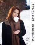young brunette woman outdoors... | Shutterstock . vector #1245467611