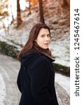 brunette young woman standing... | Shutterstock . vector #1245467614