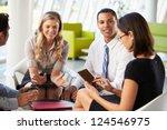 businesspeople with digital... | Shutterstock . vector #124546975