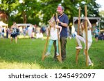 father and children walking on... | Shutterstock . vector #1245492097