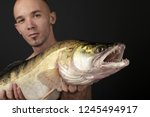 fishing. fisherman and trophy... | Shutterstock . vector #1245494917