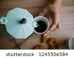 pouring coffee in a coffee cup | Shutterstock . vector #1245506584