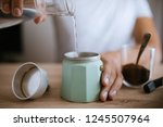 pouring water in a moka pot | Shutterstock . vector #1245507964