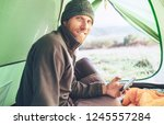 bearded traveler warm dressed... | Shutterstock . vector #1245557284