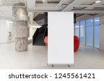 blank roll up banner stand in... | Shutterstock . vector #1245561421