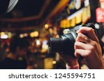 girl with vintage camera in the ...   Shutterstock . vector #1245594751