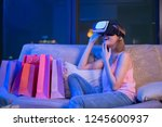 woman shopping online with vr...   Shutterstock . vector #1245600937