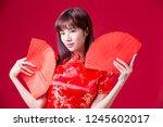 beauty woman wear cheongsam and ... | Shutterstock . vector #1245602017