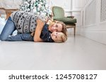 mom plays with child. lying on...   Shutterstock . vector #1245708127
