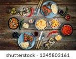 dinner table. roasted chicken... | Shutterstock . vector #1245803161