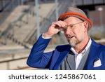 handsome man in his 50s waiting ... | Shutterstock . vector #1245867061