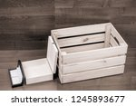 a few empty wooden boxes on...   Shutterstock . vector #1245893677