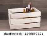 beer and wine bottles in wooden ...   Shutterstock . vector #1245893821