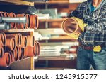 Residential Septic System Plastic Pipes. Construction Worker with a Pipe in Hand.  - stock photo