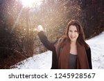 young brunette woman outdoors... | Shutterstock . vector #1245928567