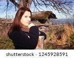 portrait of young brunette... | Shutterstock . vector #1245928591