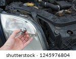 replacing the halogen lamp in...   Shutterstock . vector #1245976804