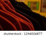 polar fleece jackets on hanger... | Shutterstock . vector #1246026877