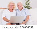 old couple using a laptop... | Shutterstock . vector #124604551