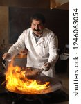 the kebab is cooked and the... | Shutterstock . vector #1246063054
