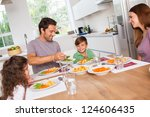 father serving vegetables to... | Shutterstock . vector #124606435