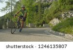young male road cyclist... | Shutterstock . vector #1246135807