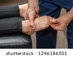 Chiropractor Pulls On The Toe...