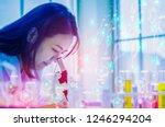 women chemist using microscope... | Shutterstock . vector #1246294204