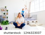 young pregnant mother is tired... | Shutterstock . vector #1246323037