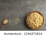 Stock photo cooked delicious quinoa in wooden bowl on table top view space for text 1246371814