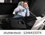 man leaned back in his chair ... | Shutterstock . vector #1246415374