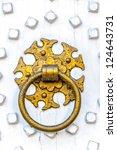 An Ornate Golden Ring Knocker...