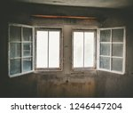 an old opened window in an...   Shutterstock . vector #1246447204