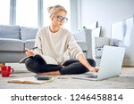woman using laptop paying bills ... | Shutterstock . vector #1246458814