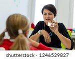 elementary age girl in child... | Shutterstock . vector #1246529827