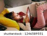 little girl studying and doing... | Shutterstock . vector #1246589551