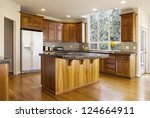 Stock photo modern kitchen with red oak wooden floors center gas stove island with stone counter tops and 124664911