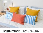 orange  yellow and blue pillows ...   Shutterstock . vector #1246763107