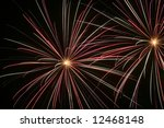 Small photo of Airburst fire works in going off in the night sky