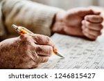 hand of a senior woman   sudoku ... | Shutterstock . vector #1246815427