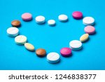 heart laid out of pills on a... | Shutterstock . vector #1246838377