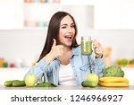 beautiful woman drinking fresh... | Shutterstock . vector #1246966927