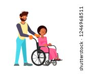 man helps young disabled... | Shutterstock .eps vector #1246968511