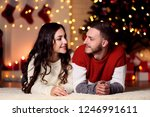 young couple lying at home near ... | Shutterstock . vector #1246991611